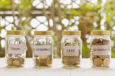 money in different glass jars intended for saving